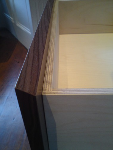 Drawer detail showing angled drawer front to create finger pull